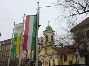 Hungarian flag and church near Keleti Train station, Budapest, Hungary. Photo, my own.